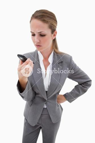 Irritated bank employee reading text message