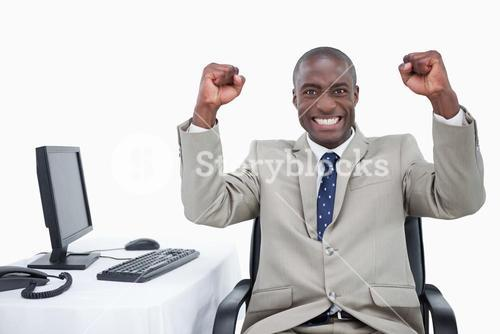 Successful salesman with the fists up