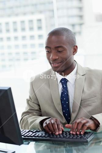 Portrait of a happy office worker using a computer