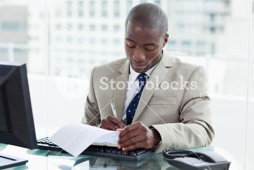 Young entrepreneur signing a document