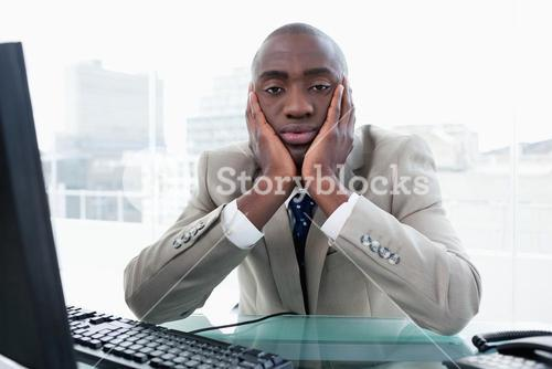 Bored businessman posing