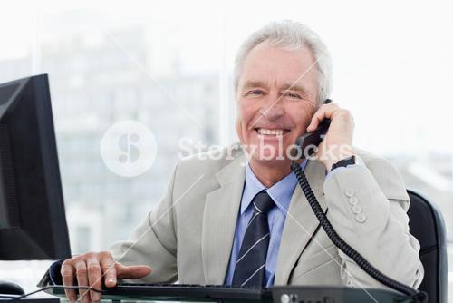 Smiling senior manager on the phone