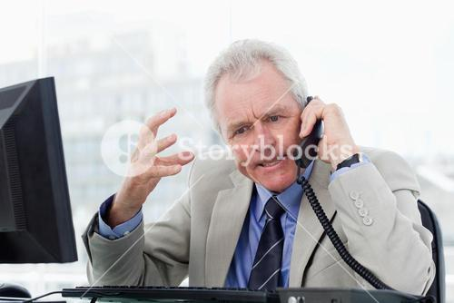 Angry senior manager on the phone