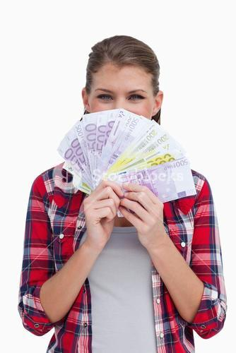 Portrait of a rich woman holding bank notes