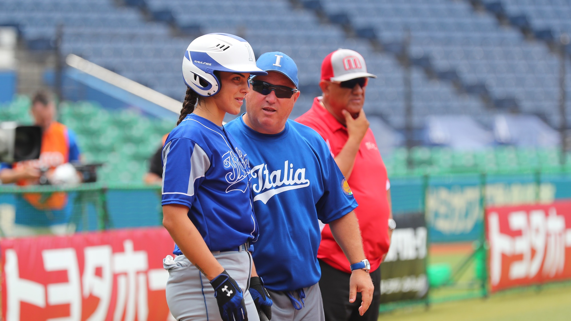 Italy's third base coach Pizzolini talks to catcher Erika Piancastelli