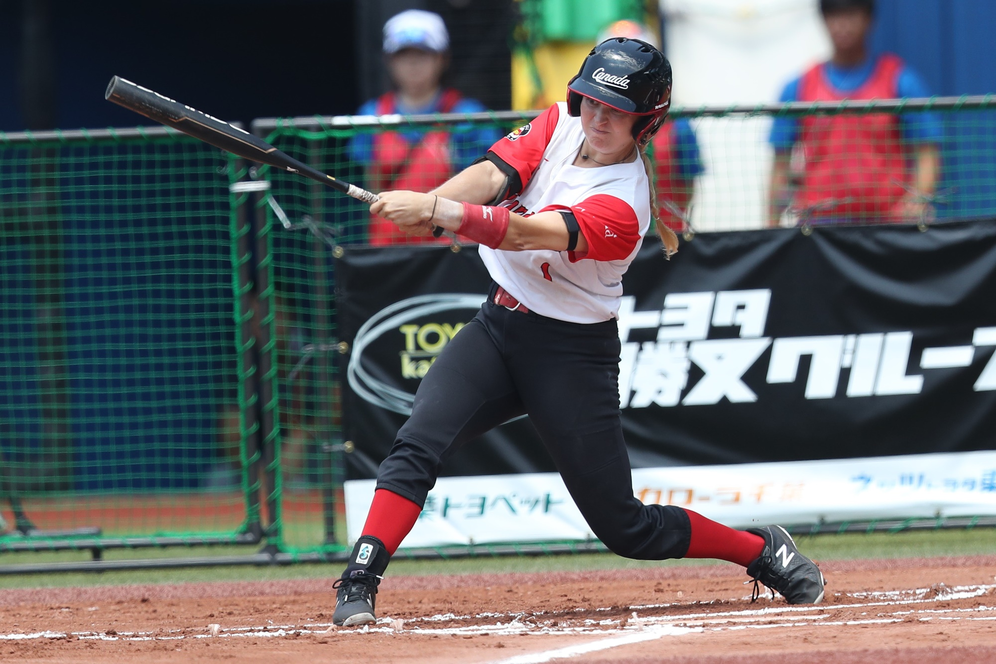 Canada slugged four home runs against Puerto Rico. Here Erika Polidori swings for the fences