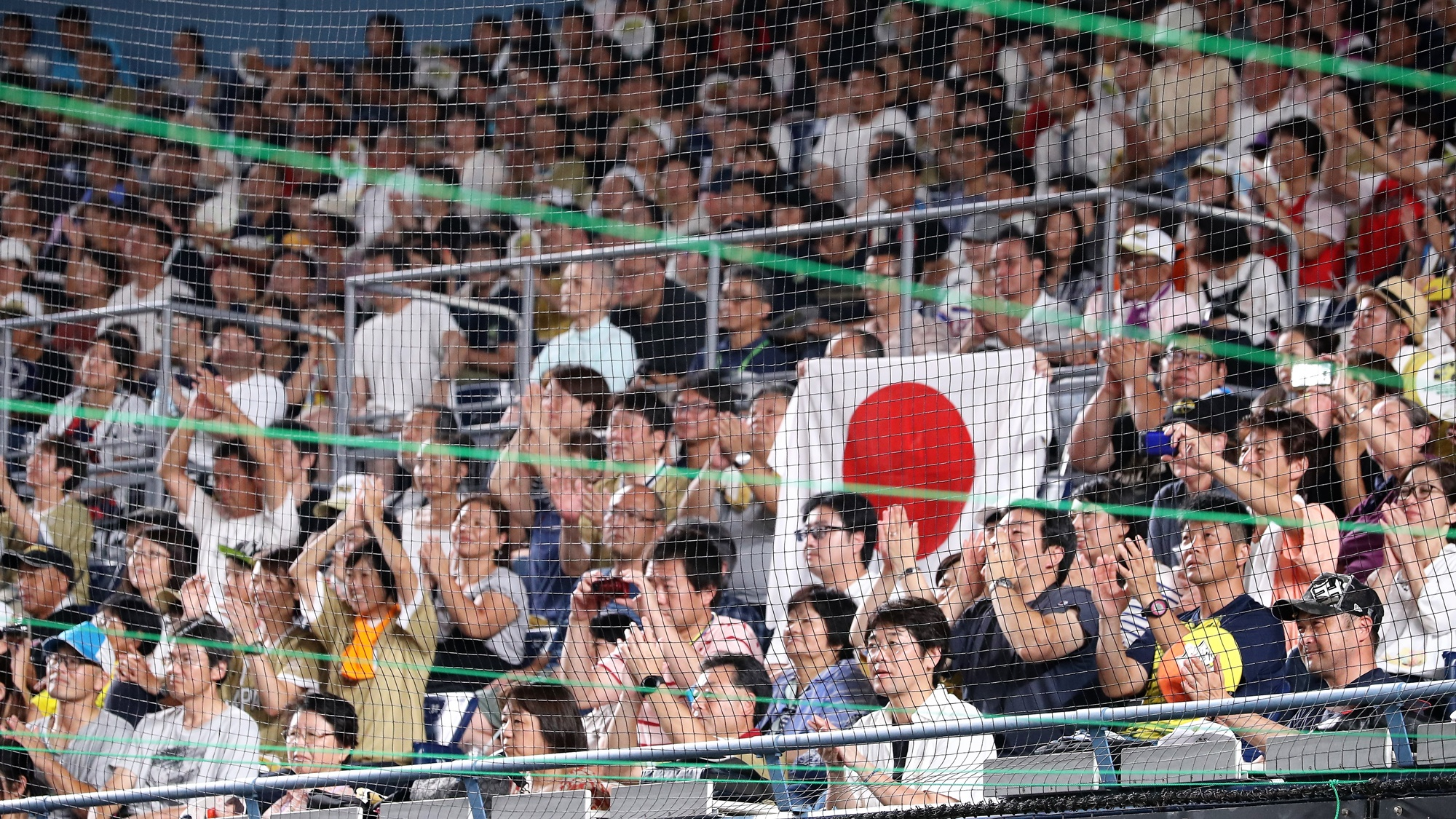 A raucous crowd of over 11,000 supported Japan