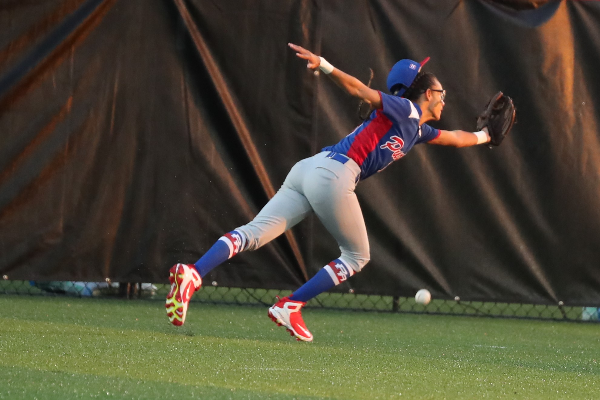 Nylah Ramirez cannot get to a deep fly ball by Malaika Underwood