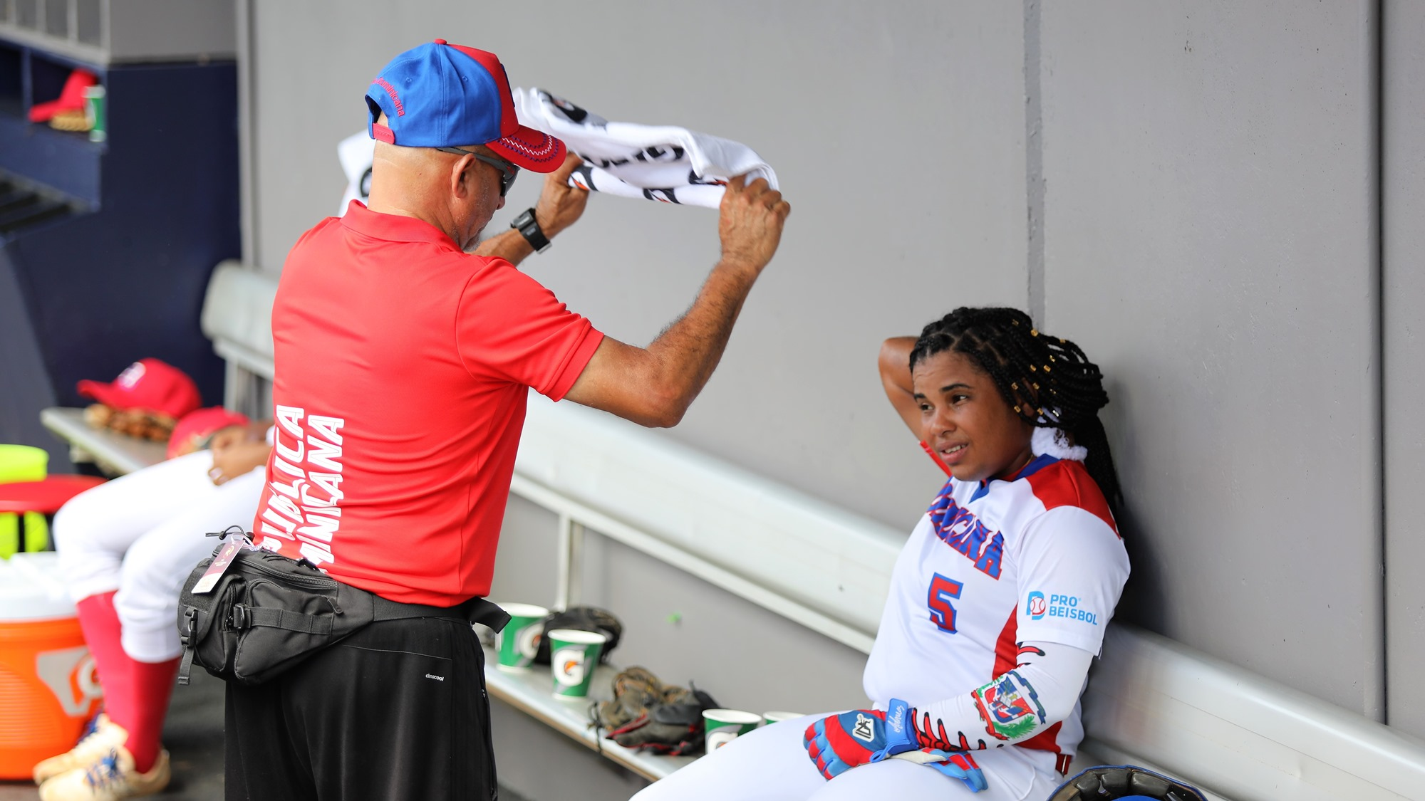Yomela Gomez of Dominican Republic tries to manager heath