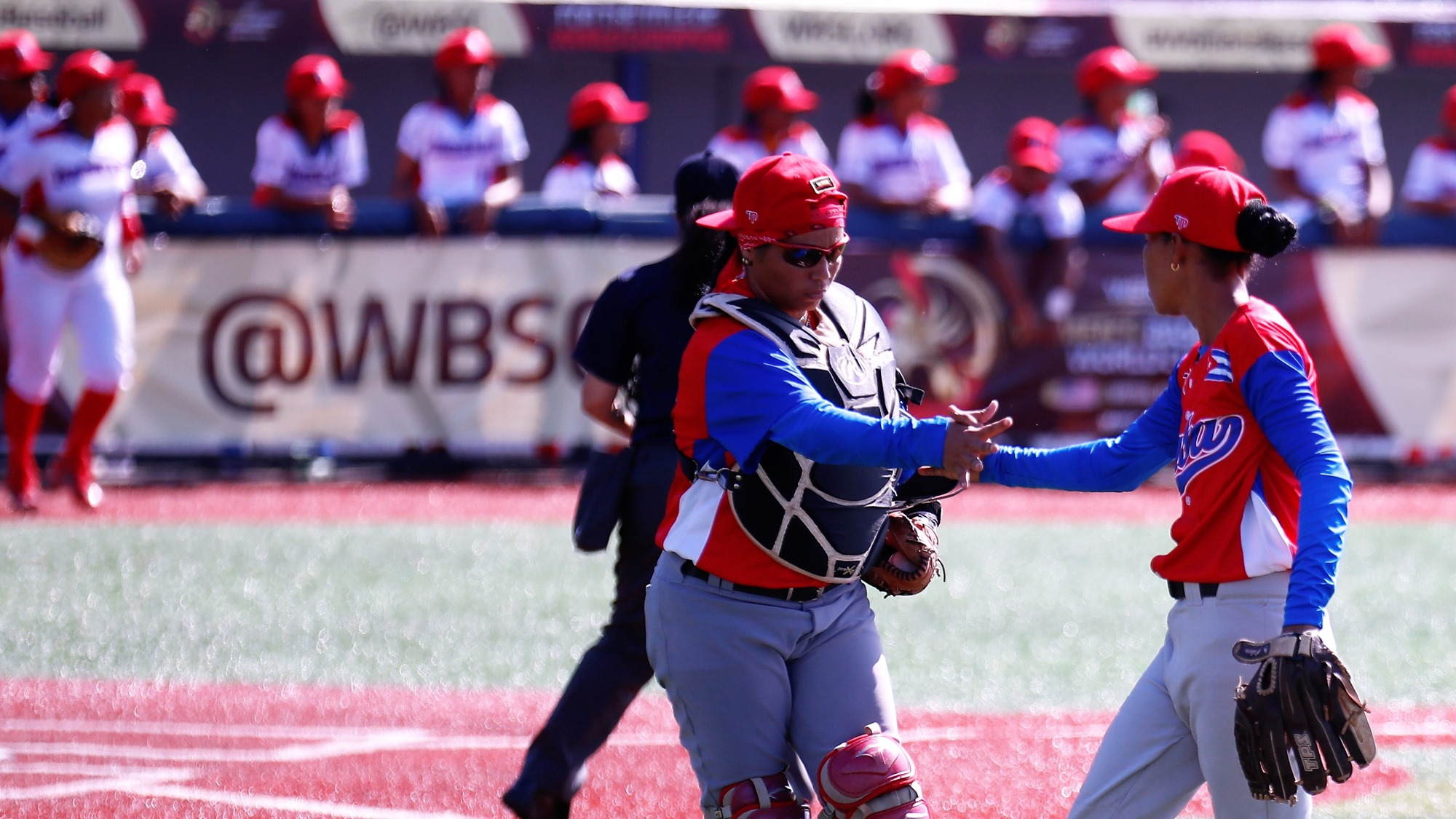 Catcher Yordanka Rodriguez congratulates Porro after the game with the Dominican Republic