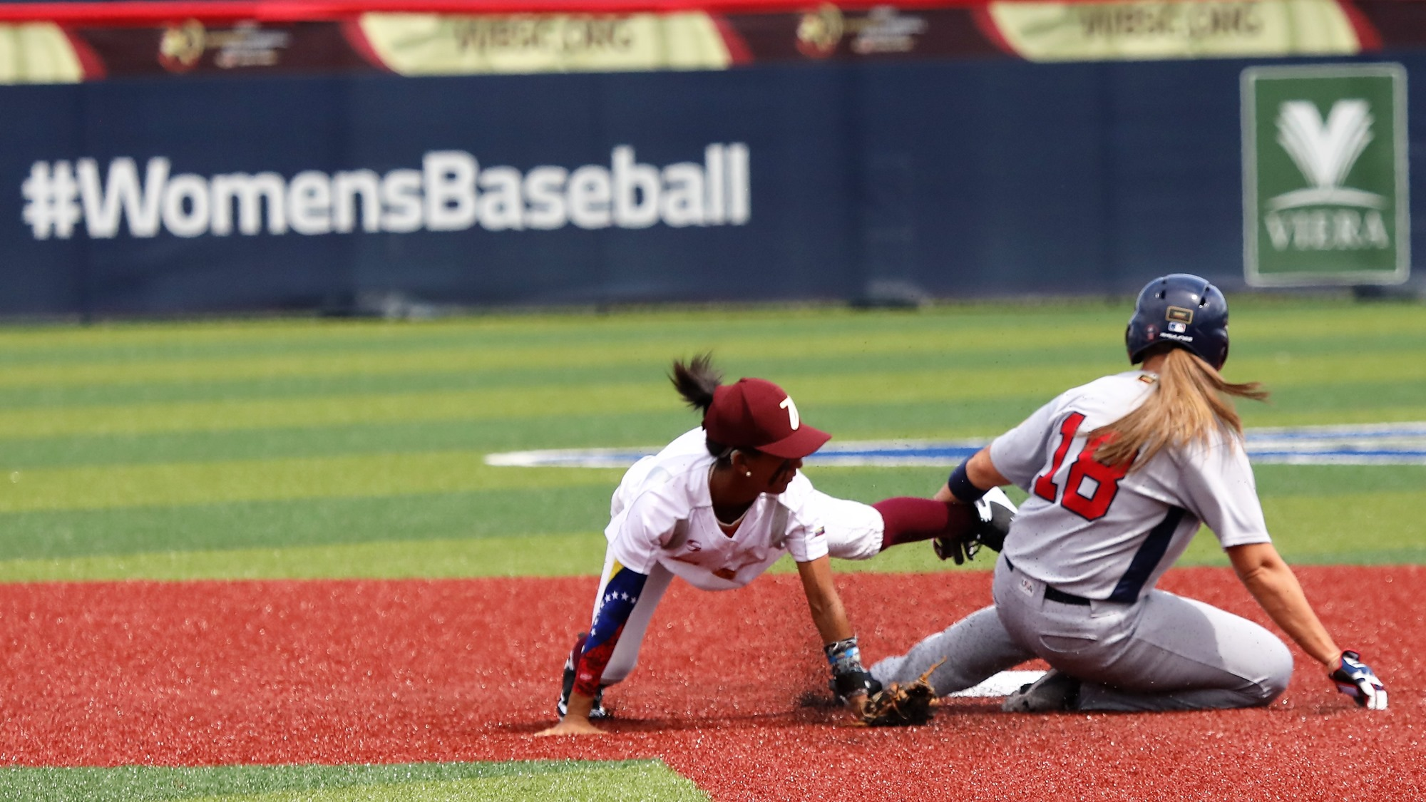 Michelle Cobb slides into second to avoid a tag by Maigleth Torres