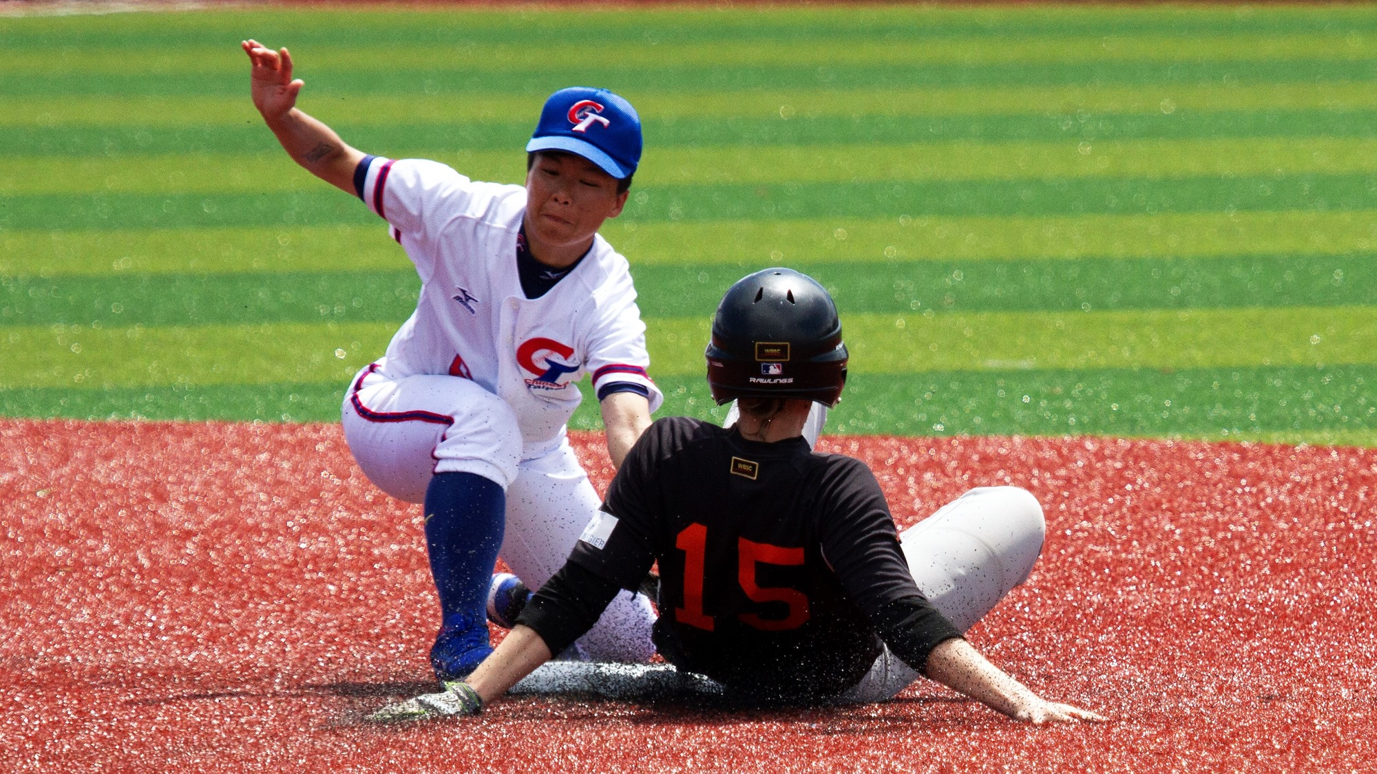 Sofie Van der Wiel slides into second to avoid a tag by Tsai Ming Chen