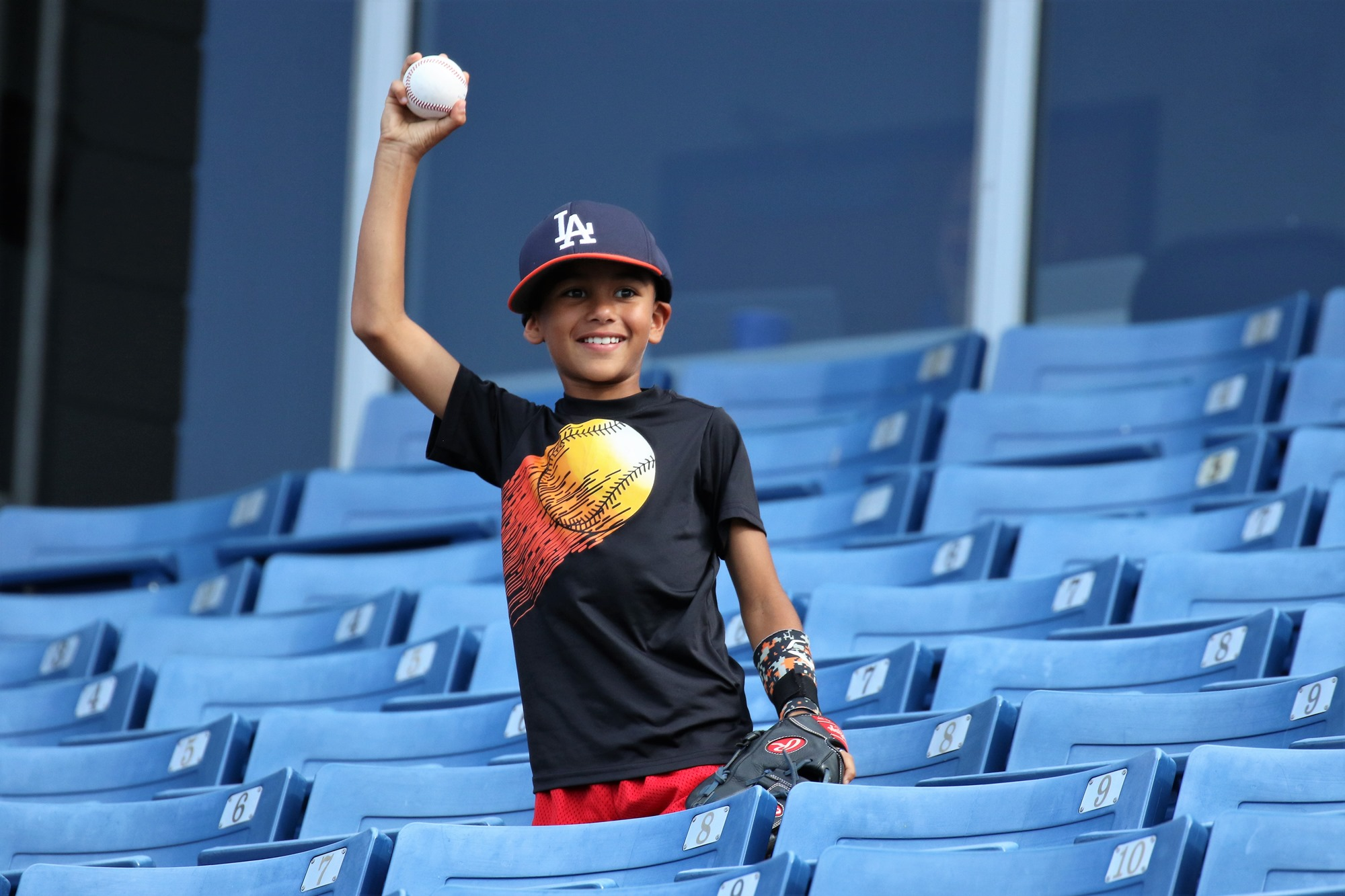 The young Venezuela fan goes home with a souvenir ball