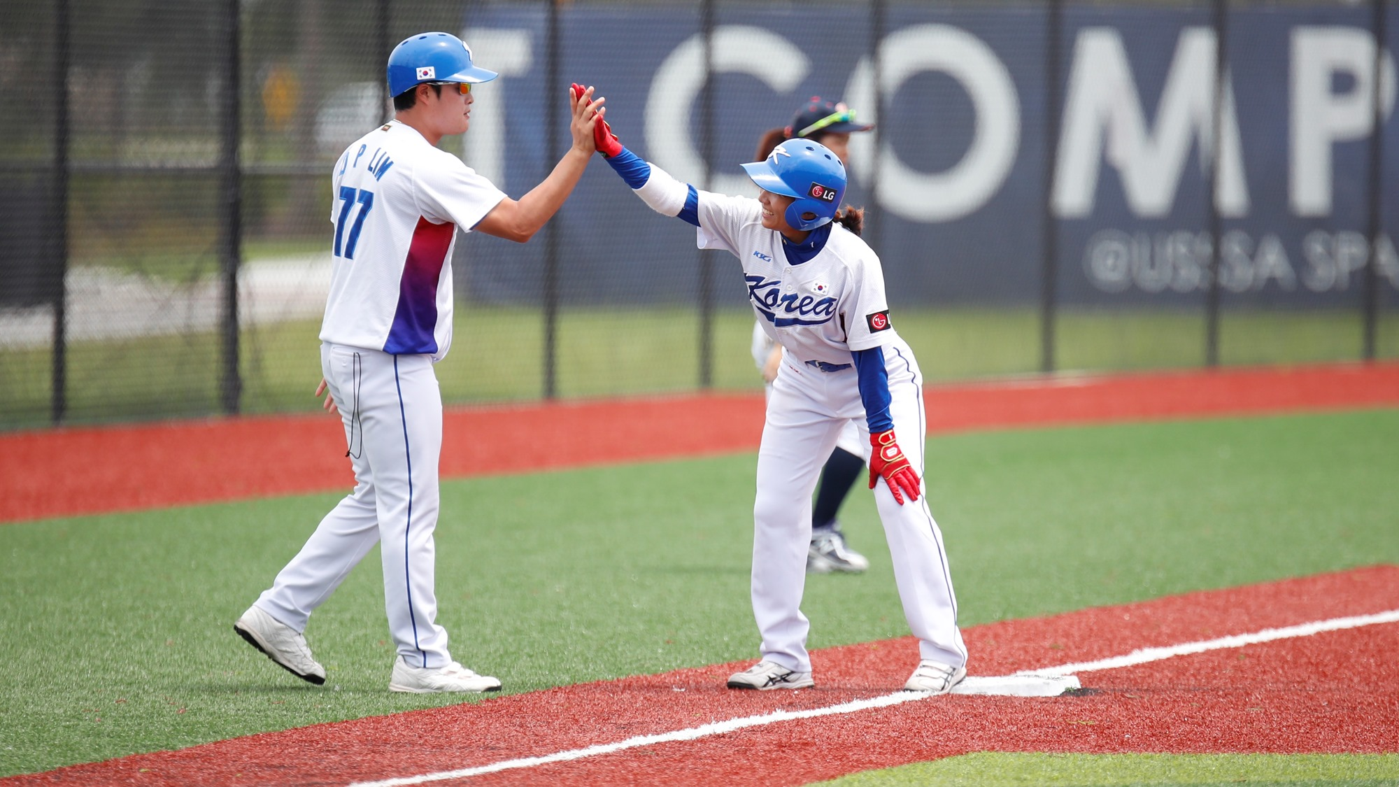 Korea's third base coach congratulating his player