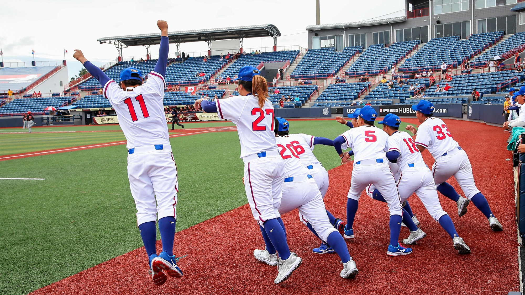 Chinese Taipei dugout flies onto the field after the third out