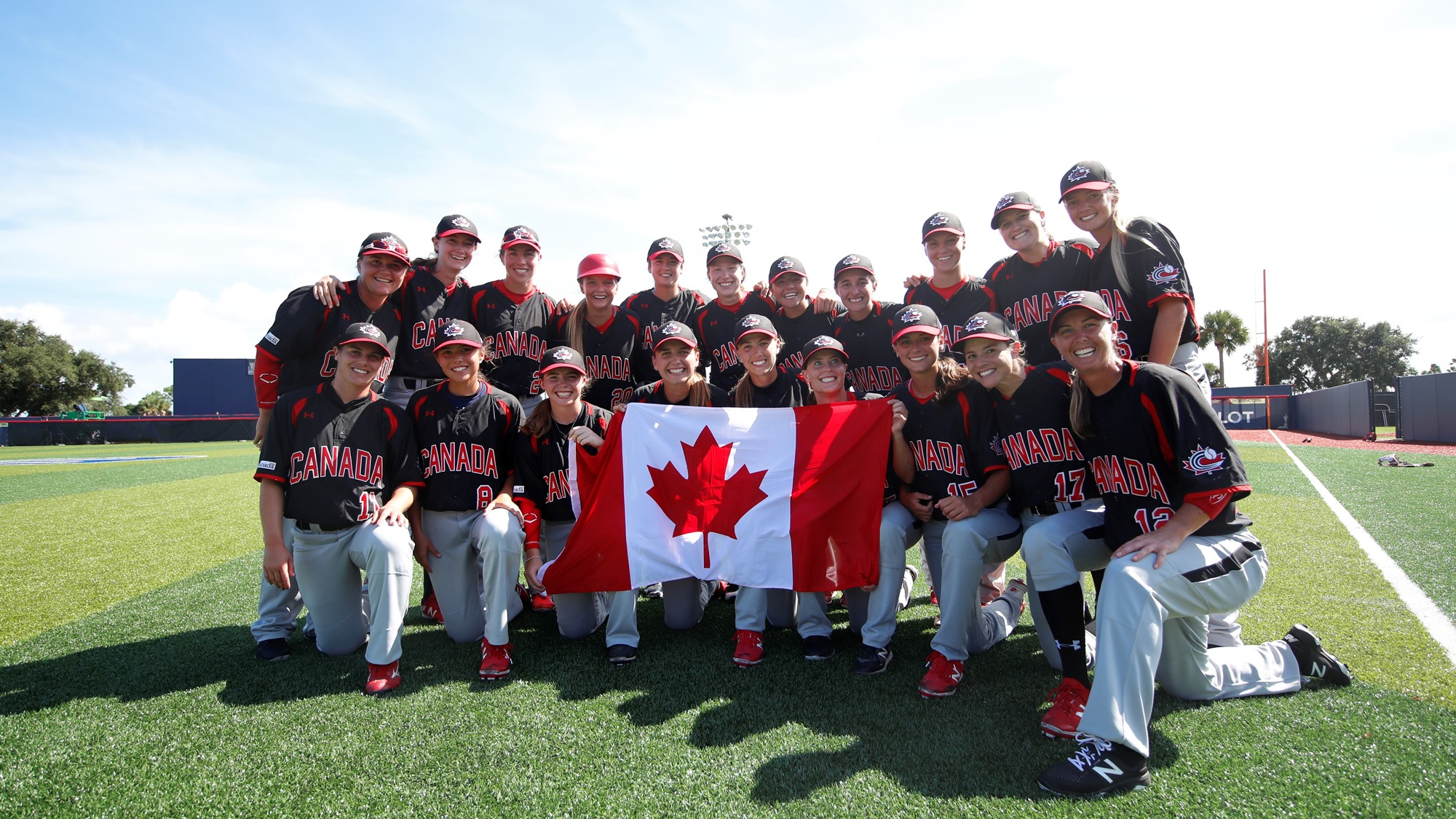 Canada posing with the National Flag