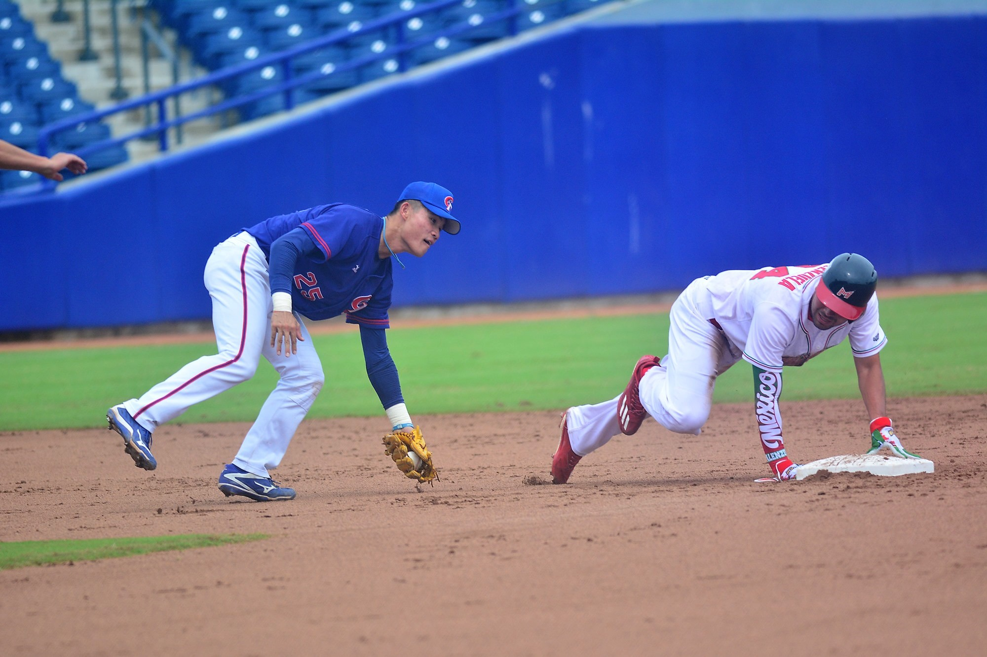 Mexico's Marco Jaime tries to avoid a tag by Cheng Hao Chun of Chinese Taipei
