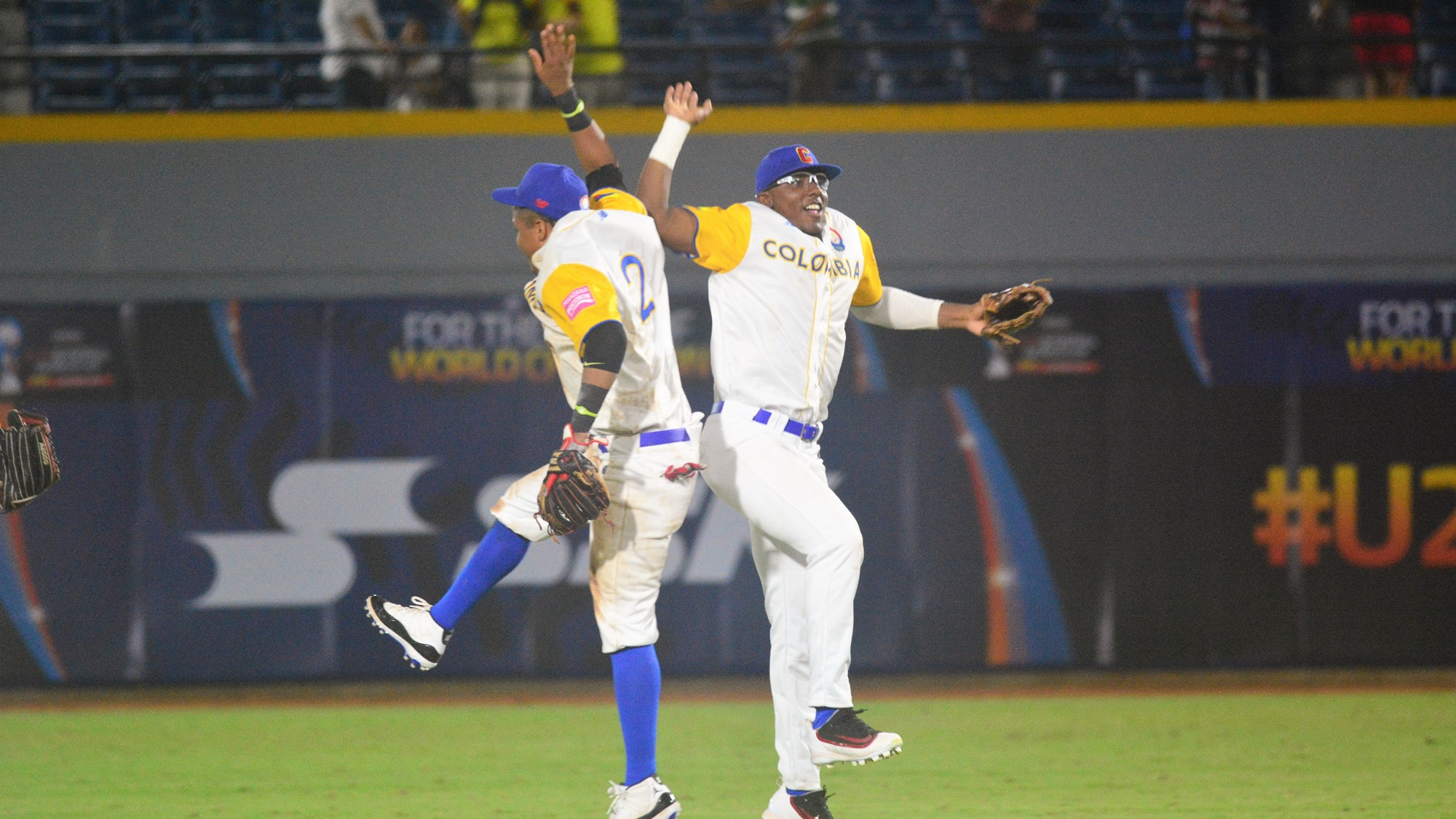 Milton Ramos and Bryan Perez celebrate after the last out