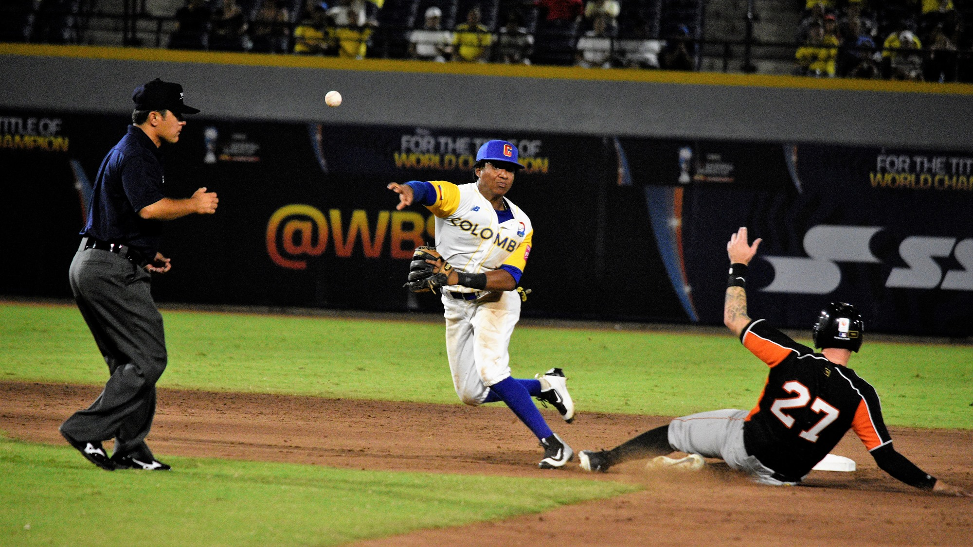 Early in the game Colombia manufactured two double plays. Milton Ramos turns one over Ruar Verker
