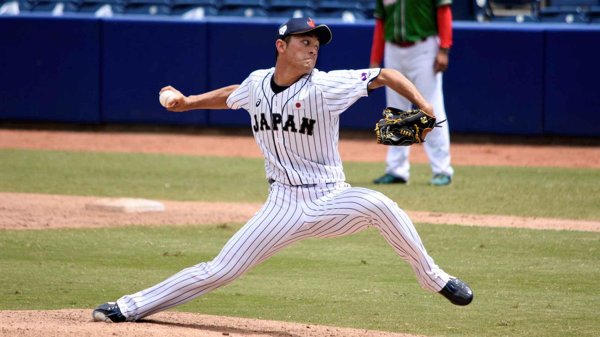 Left hander Kakeru Narita got a key bases loaded out for Japan coming from the bull pen