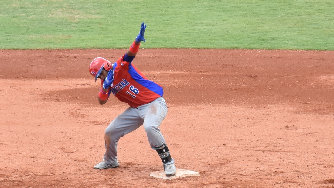 Wendell Rijo celebrates a double in the ninth inning