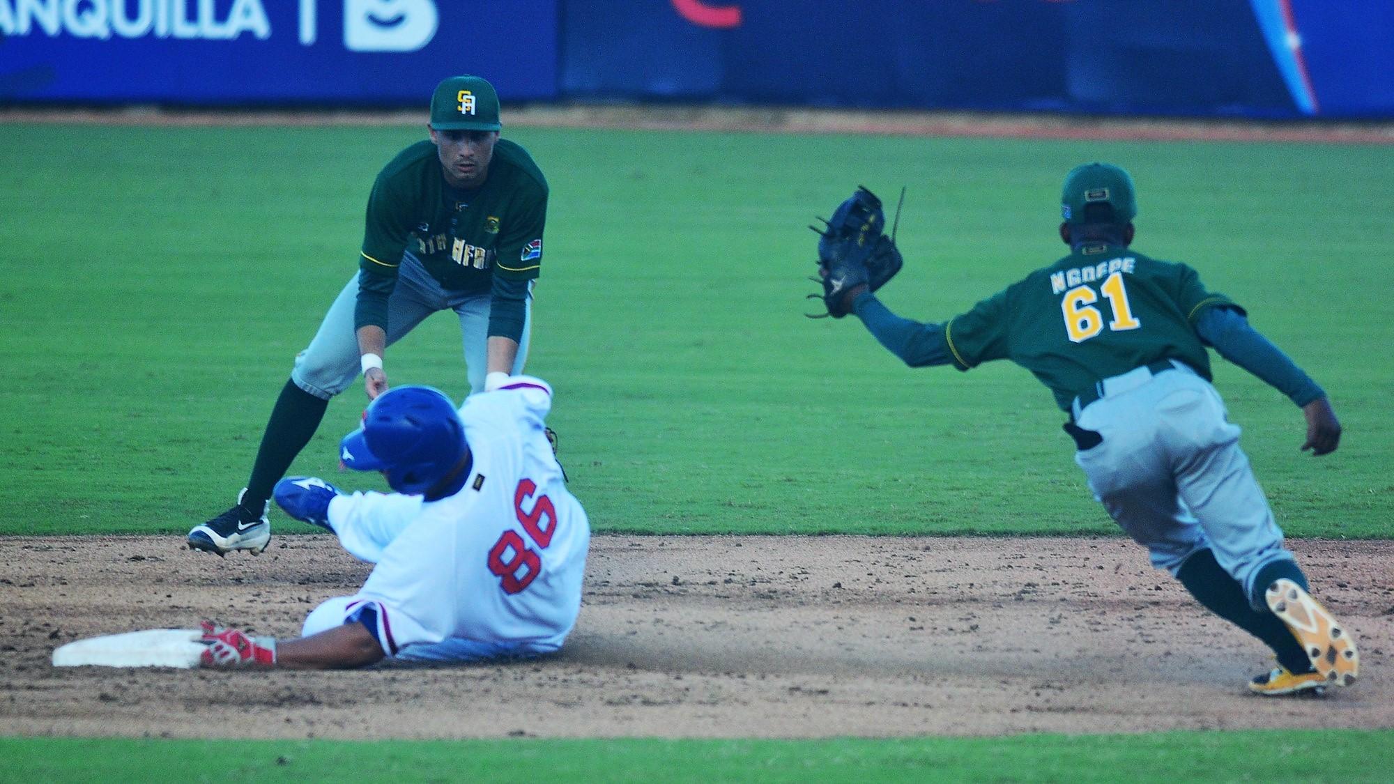 Li Yu Chuan slides in between Victor Ngoepe and Nicolas Eagles