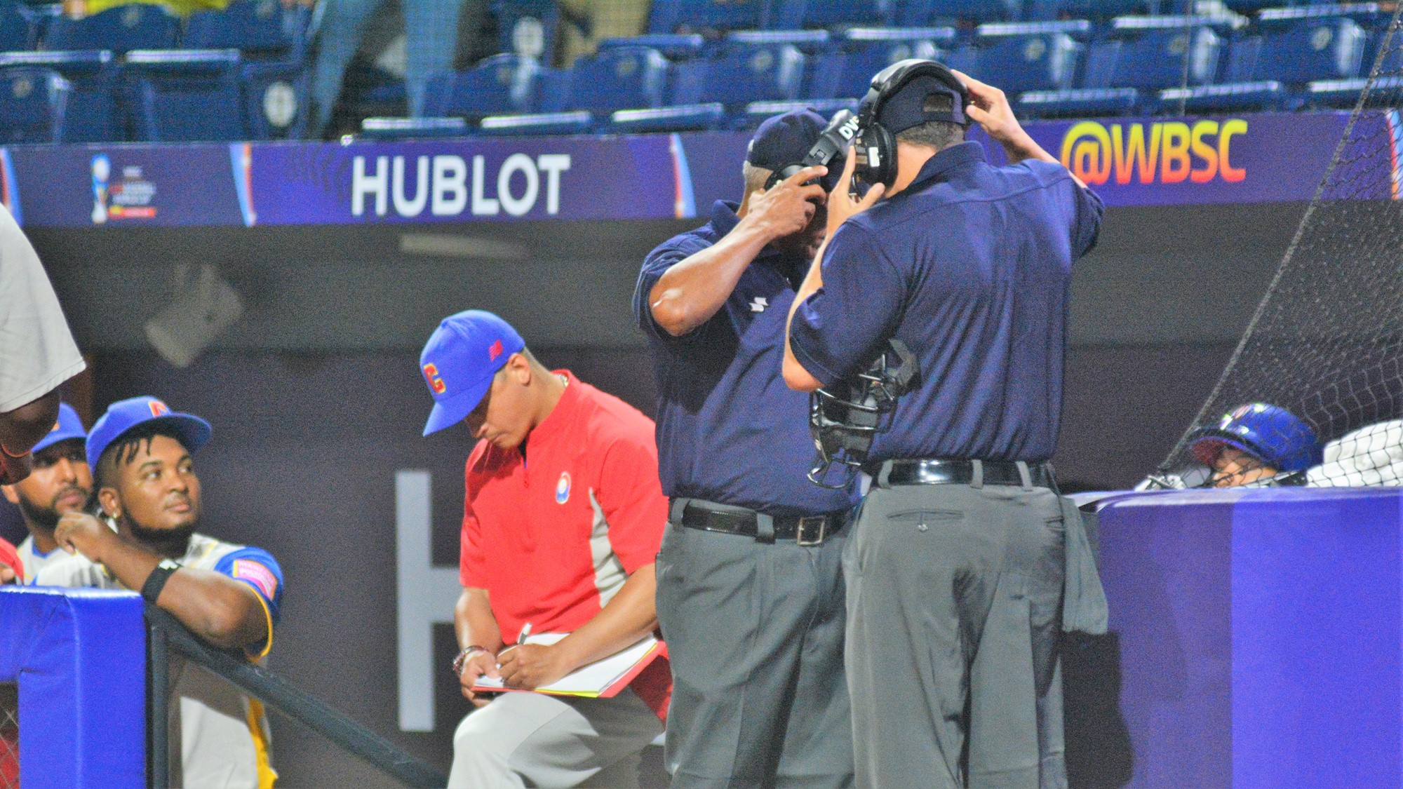 When Colombia lost the potential go ahead run at home plate, they challenged the call. But the umpire's decision survived instant replay