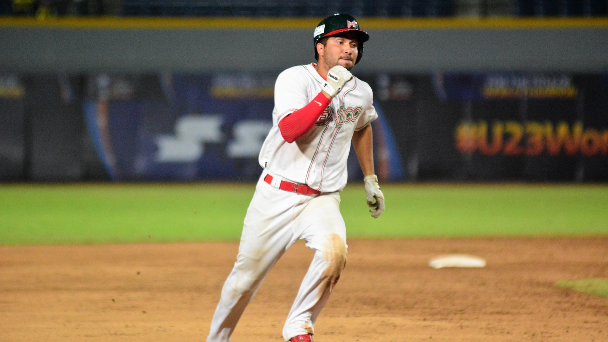 Walter Higuera heads home to score the winning run