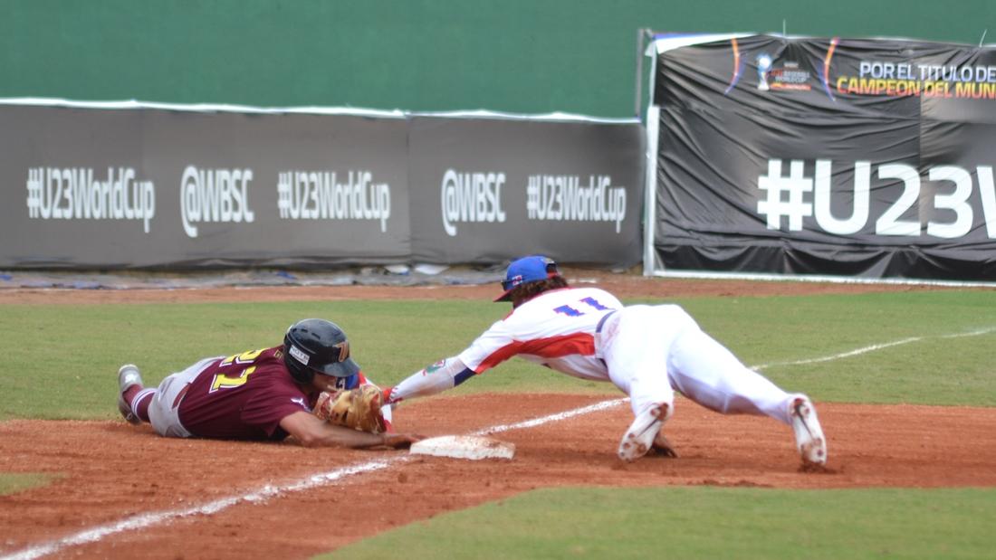 Eguyr Rosario makes the tag at third base