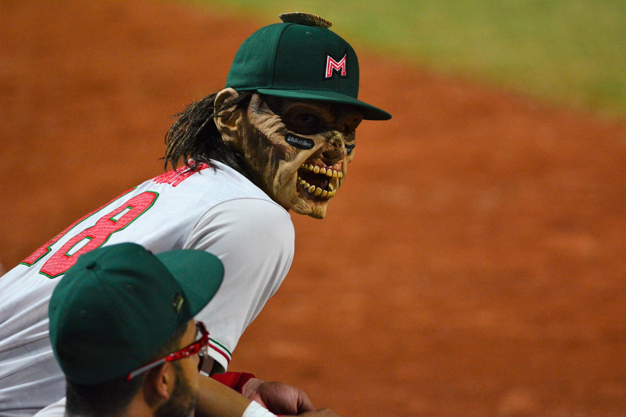 Mexico's Angel Erro loves his Lucha Libre mask in the dug out