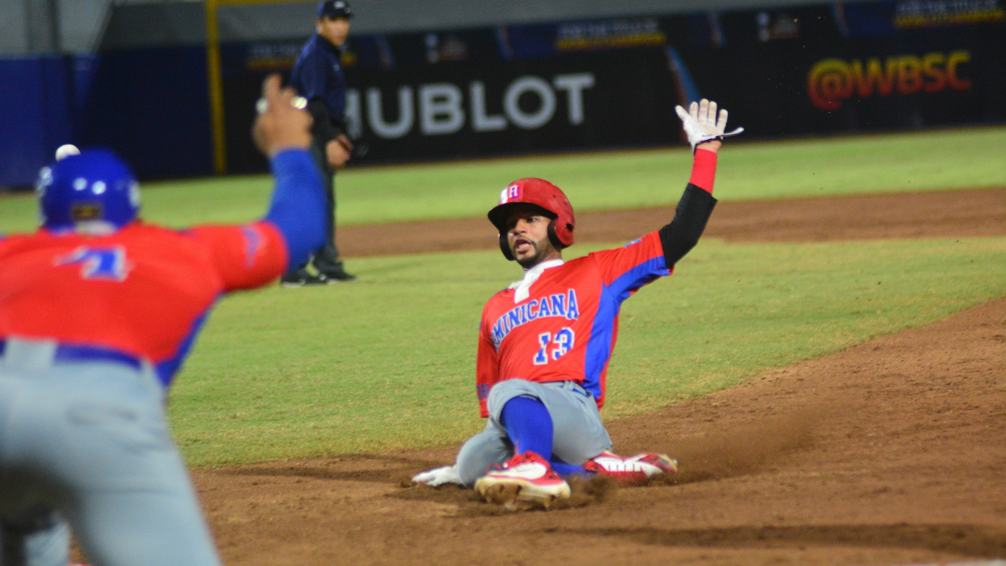 Gilberto Celestino of the Dominican Republic slides into third