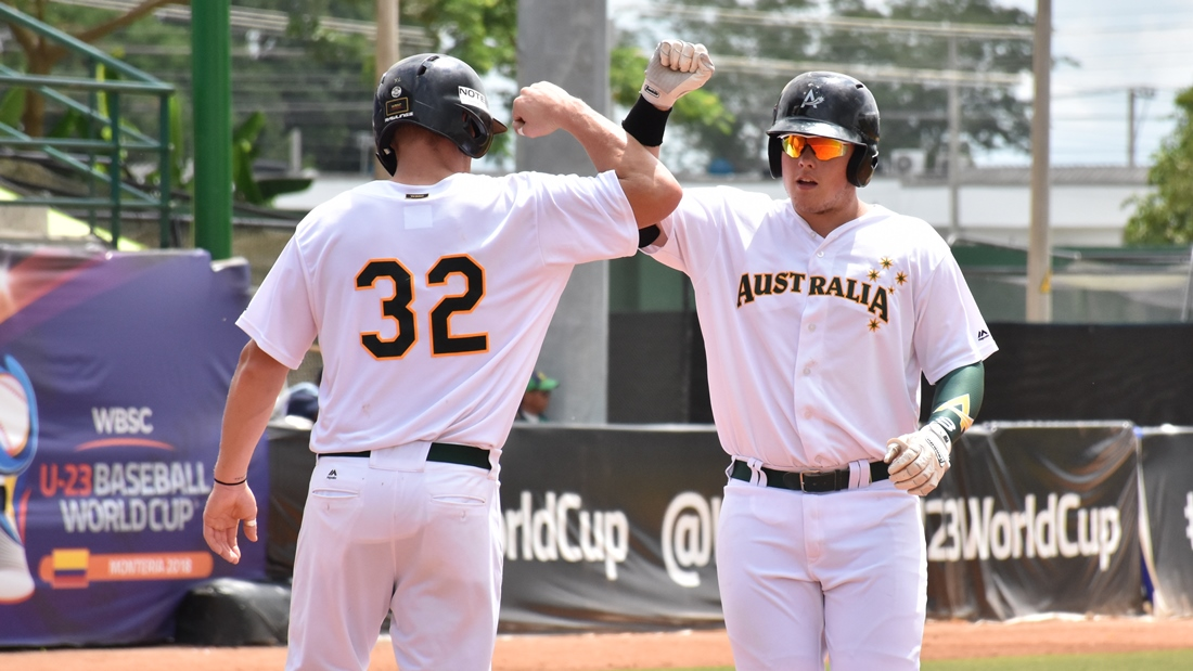 Jordan McArdle celebrates his home run with Jack Barrie