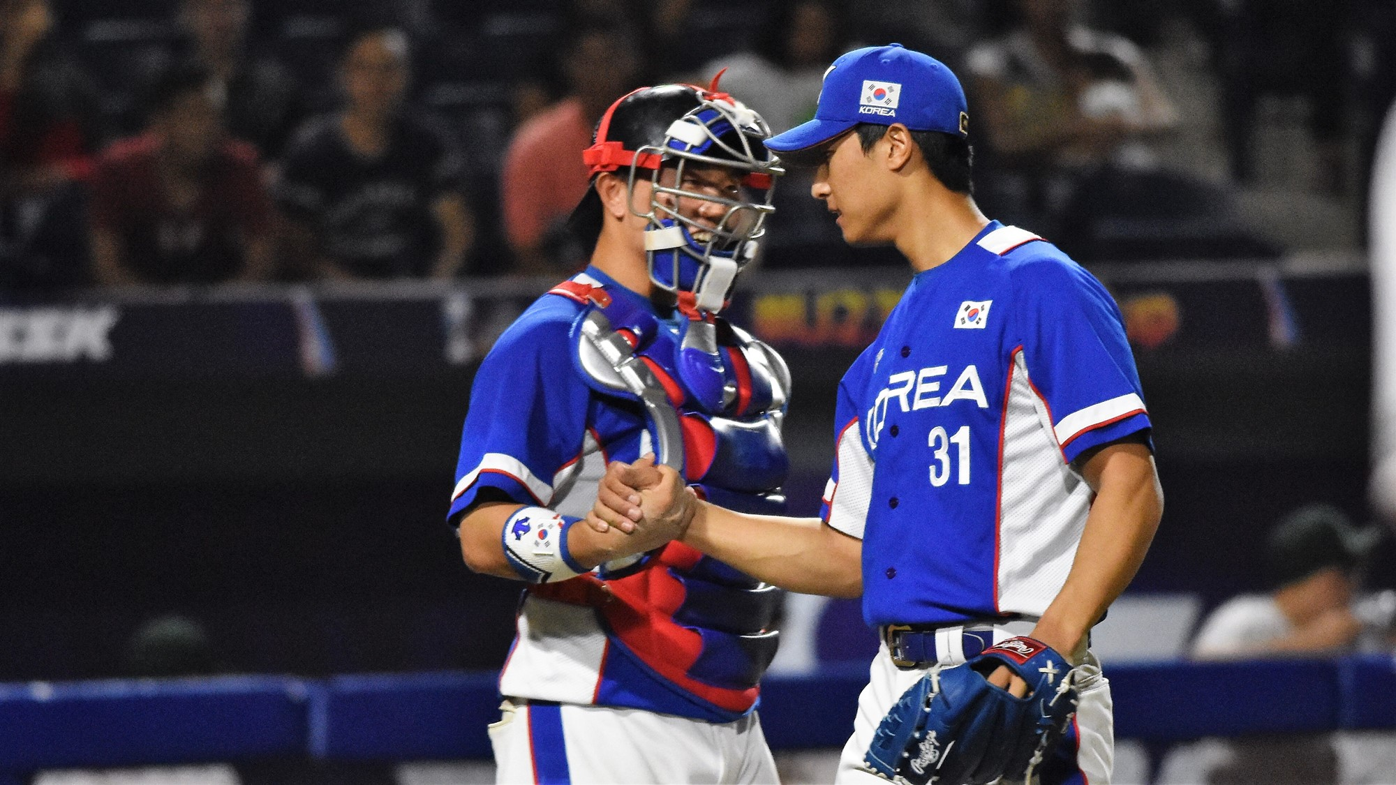 Catcher Park Yu Yeon congratulates reliever Ji Yung Yong at the end of the game
