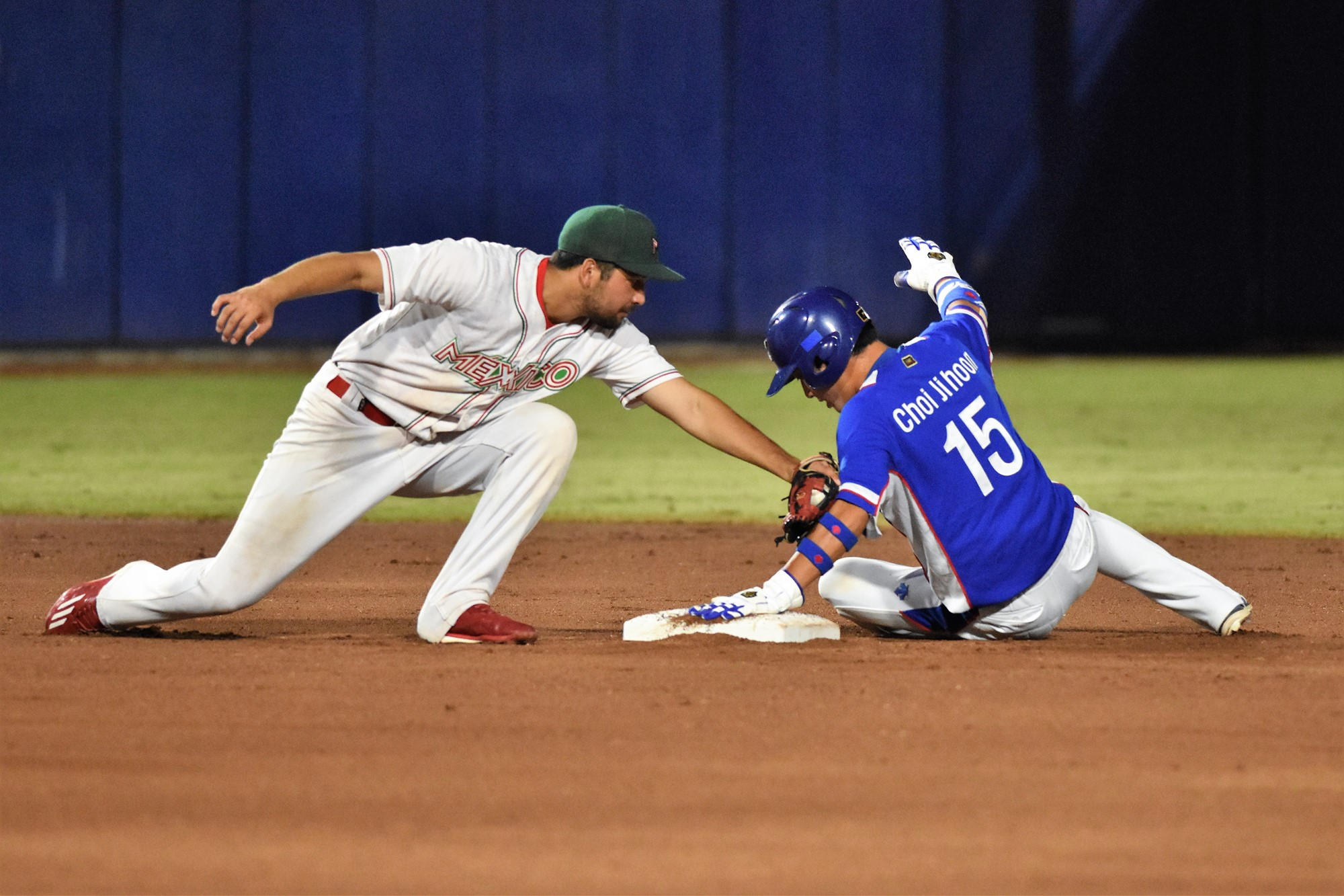 Mexico's Roberto Valenzuela defends second on a slide by Choi Ji Hoon