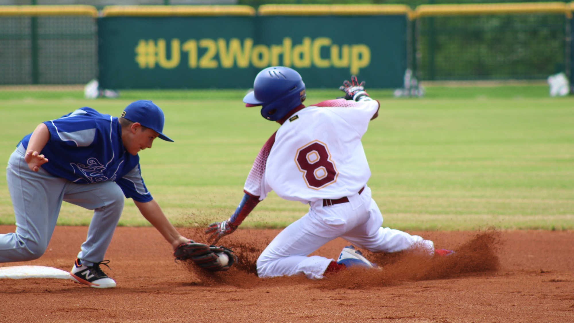 Italian shortstop Ruggeri tags Venezuela's Blanco for the out
