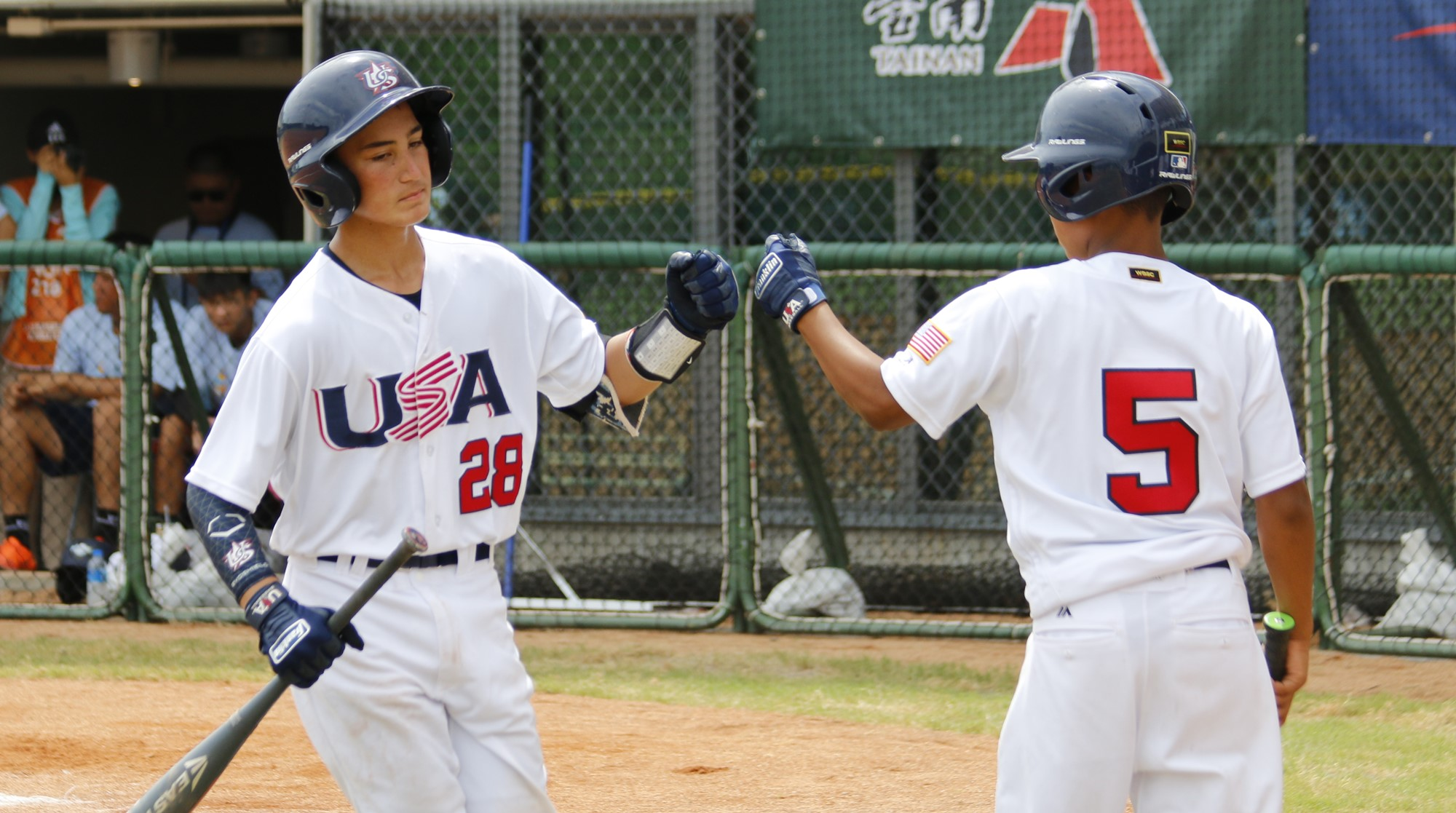 John Dolan and Brenden Lewis celebrate a run for the USA
