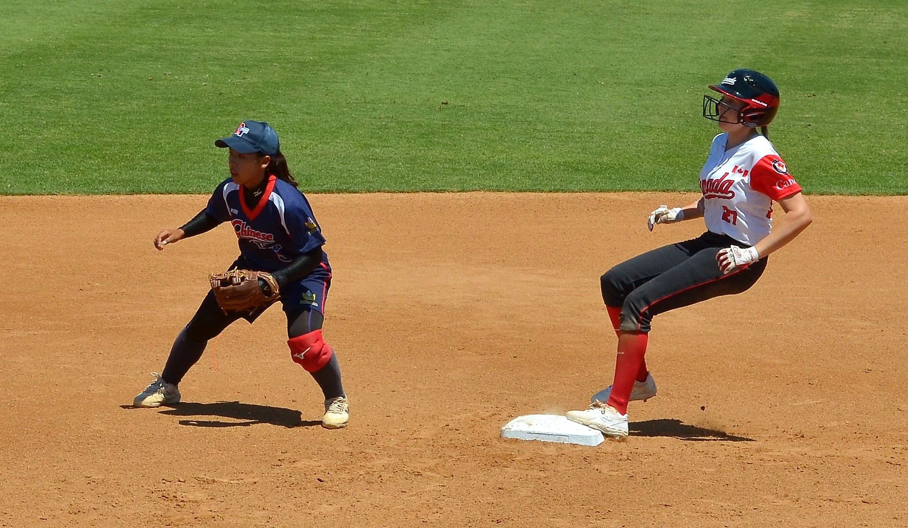 Canada running the bases against Chinese Taipei