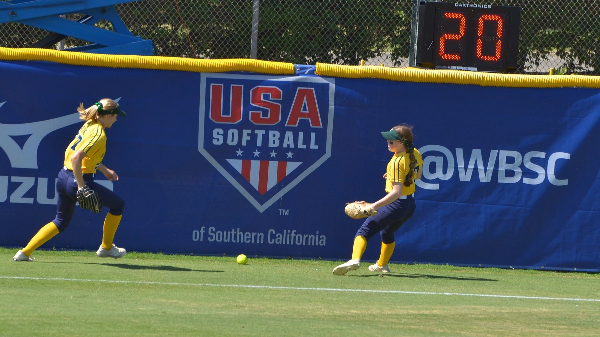 Australia's outfielders chasing the ball hit by Shiharashi in the second