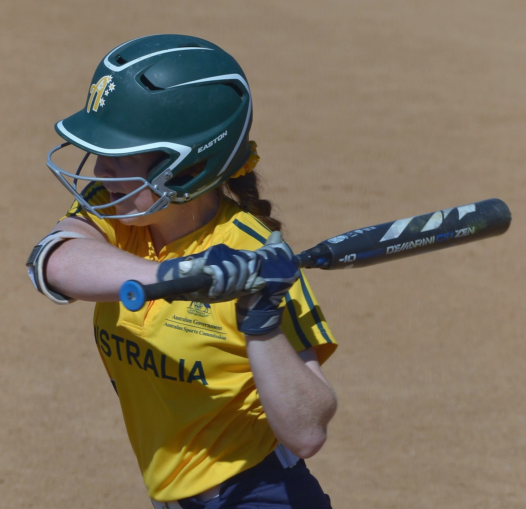 A two out single in the bottom of the fourth broke the tie between Australia and Italy