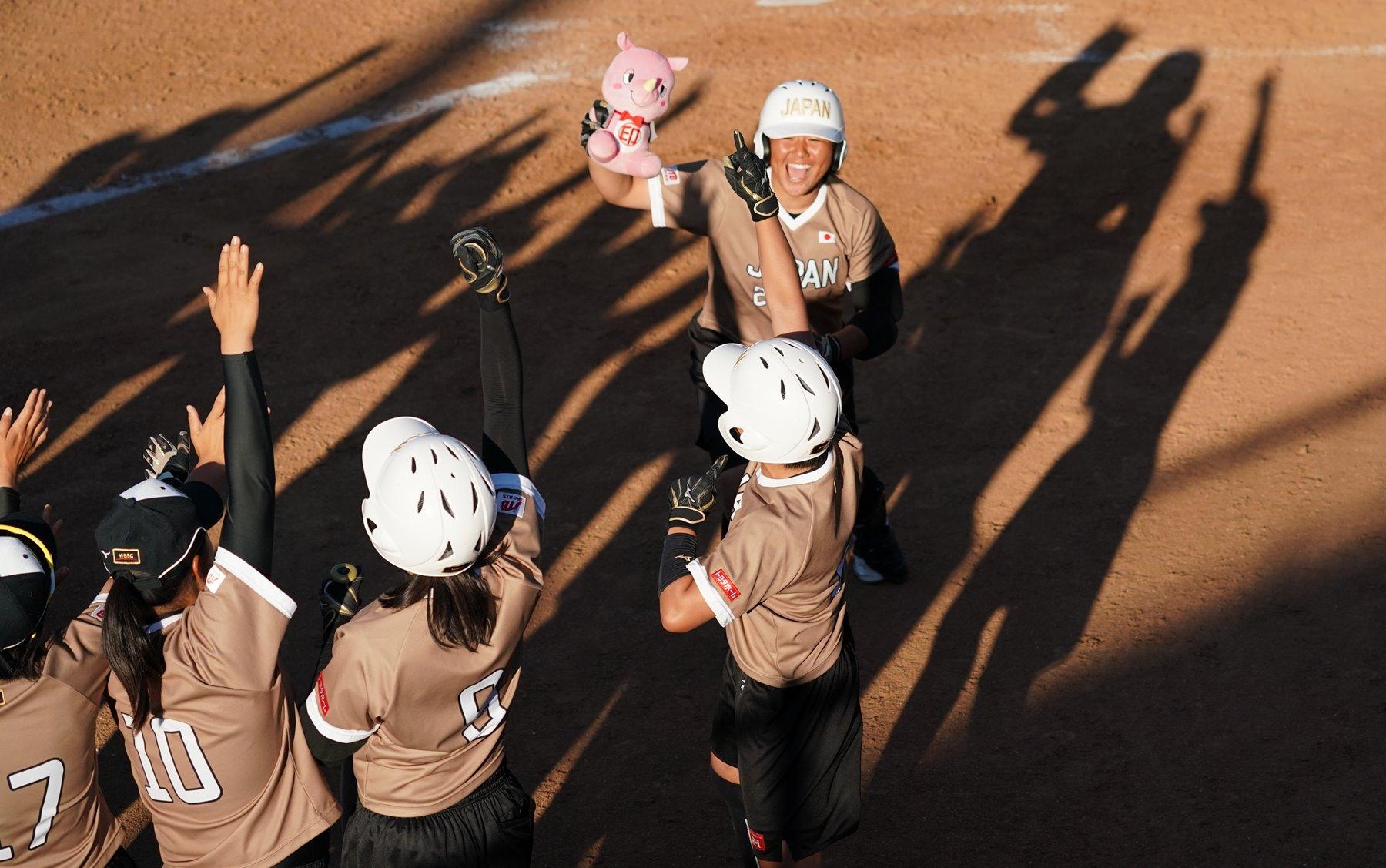 Catcher Haruki Sumitani celebrated after her home run
