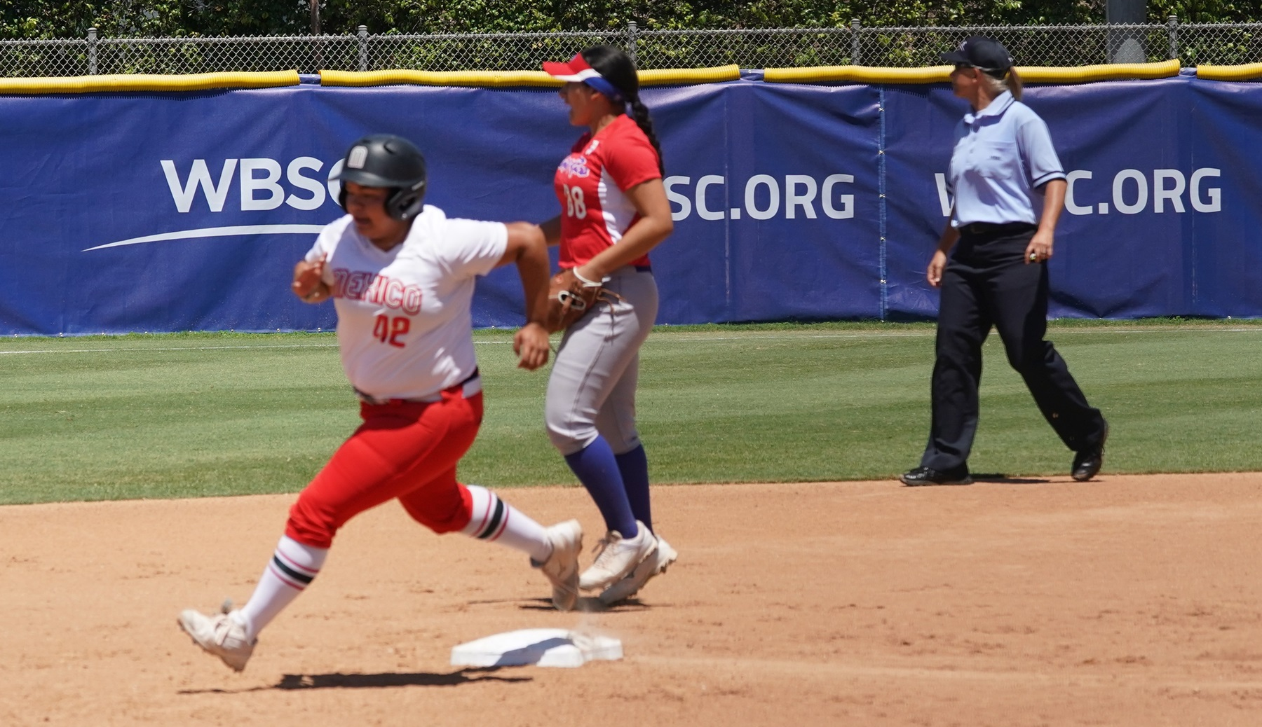 Once Mexico had the lead, cound not extend it. Desiree Hernandez tried to score from first on a double