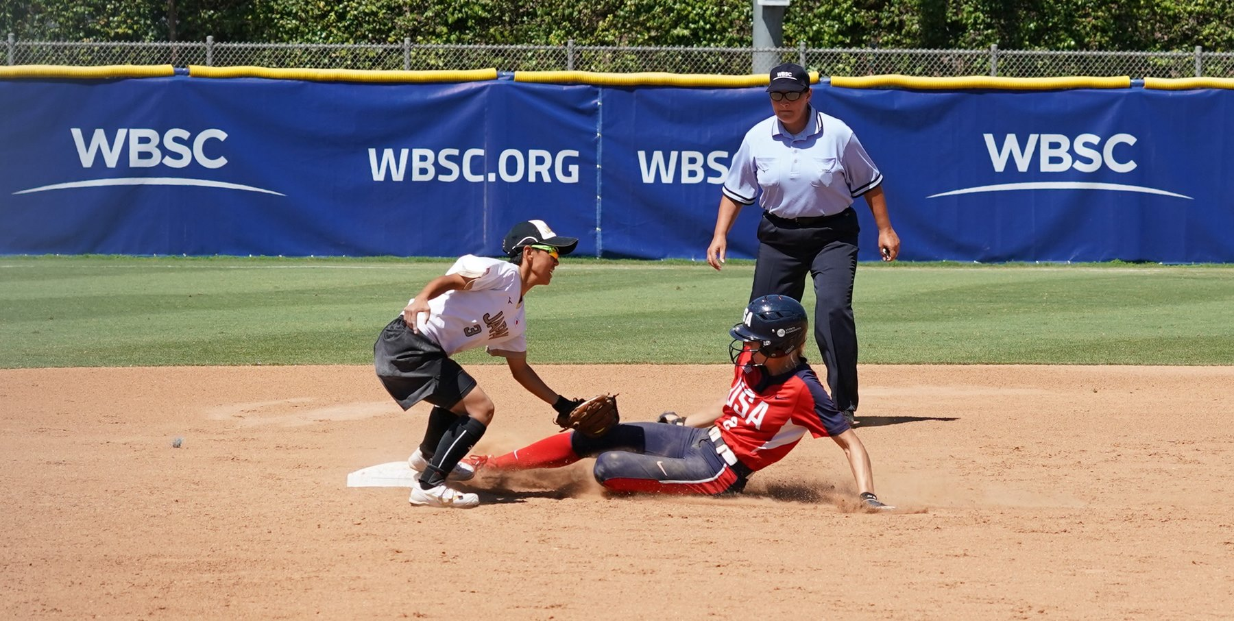 Even speedy Skylar Wallace can get caught stealing by Japan's catcher Ako Imamura