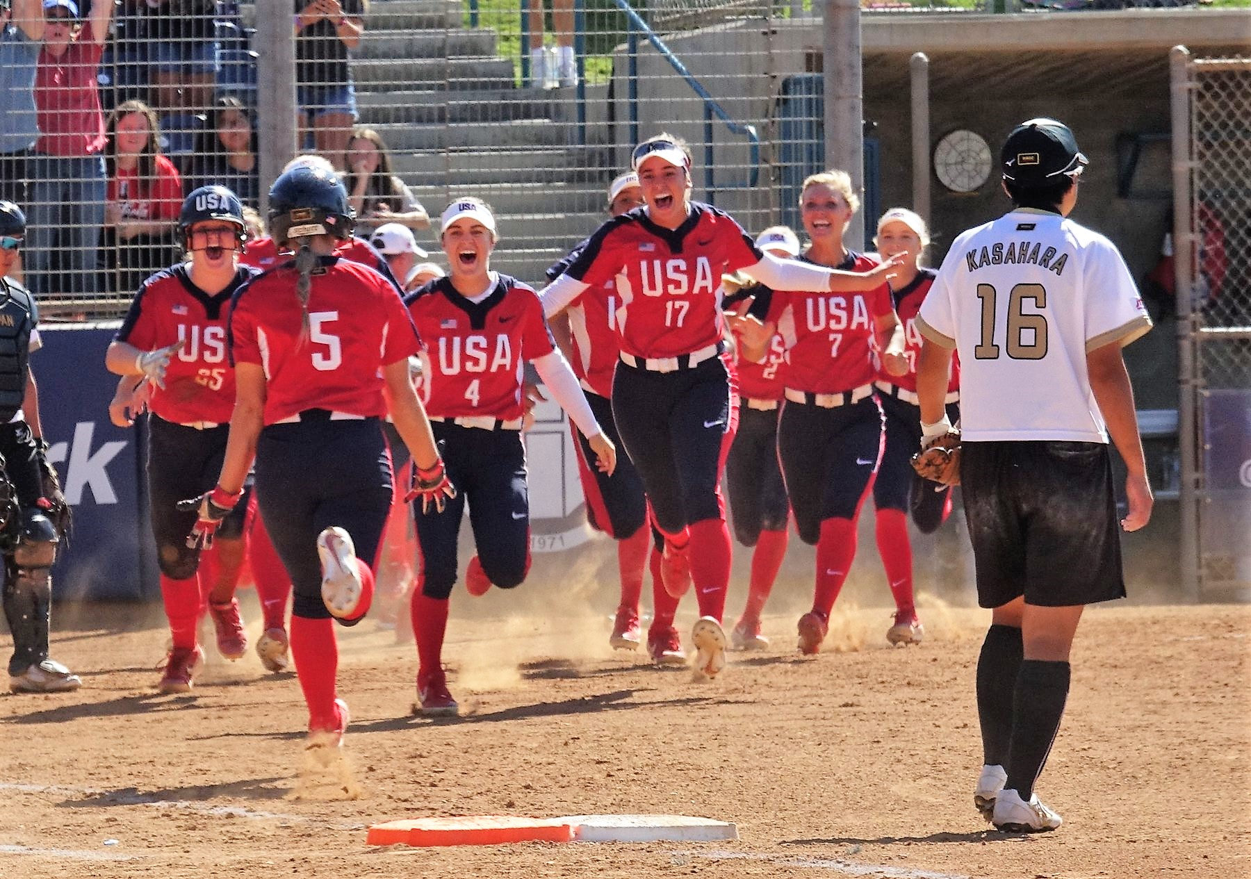 The USA celebrate Jasmine Freed after her walk-off base hit