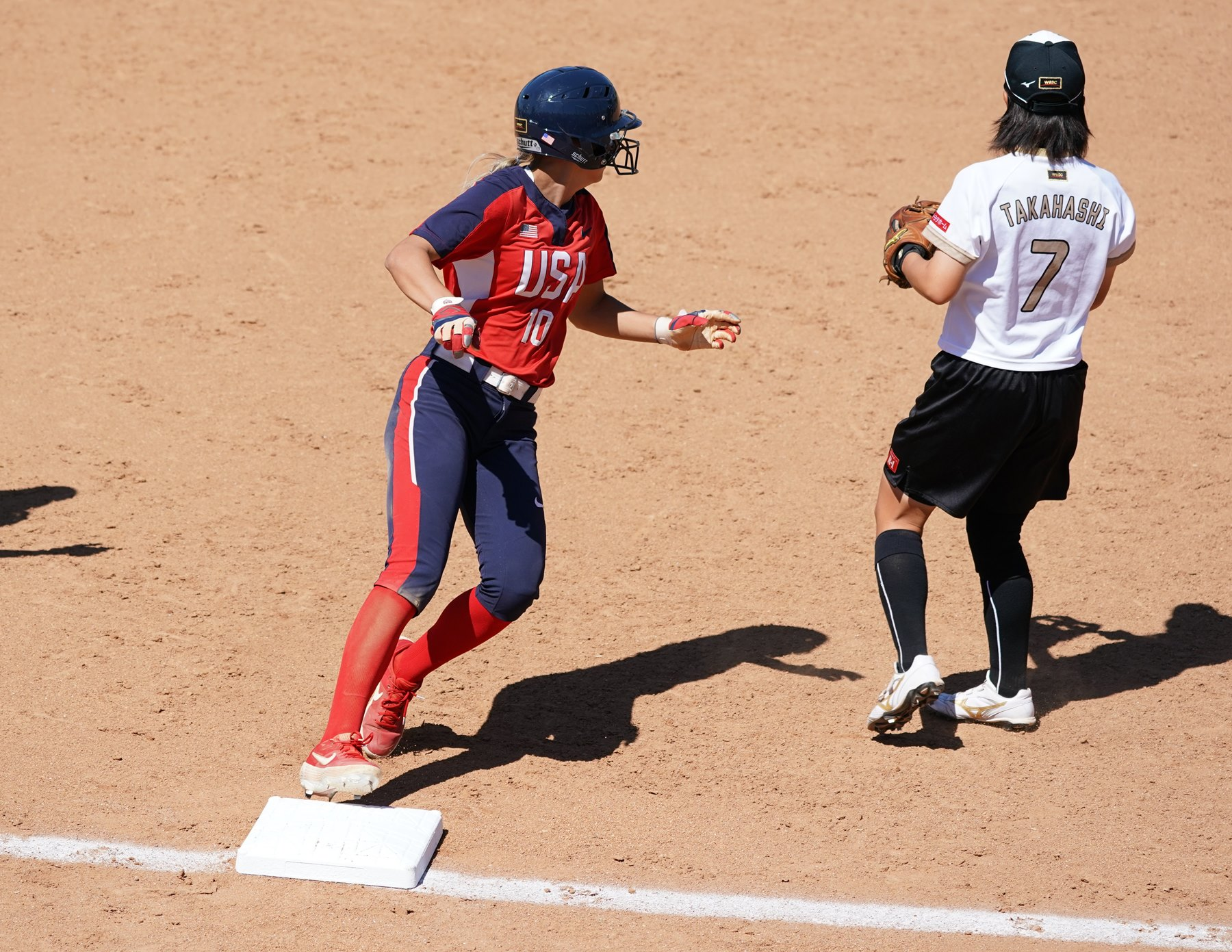 Jayda Coleman standing at third with Mahiro Takahashi waiting for the throw