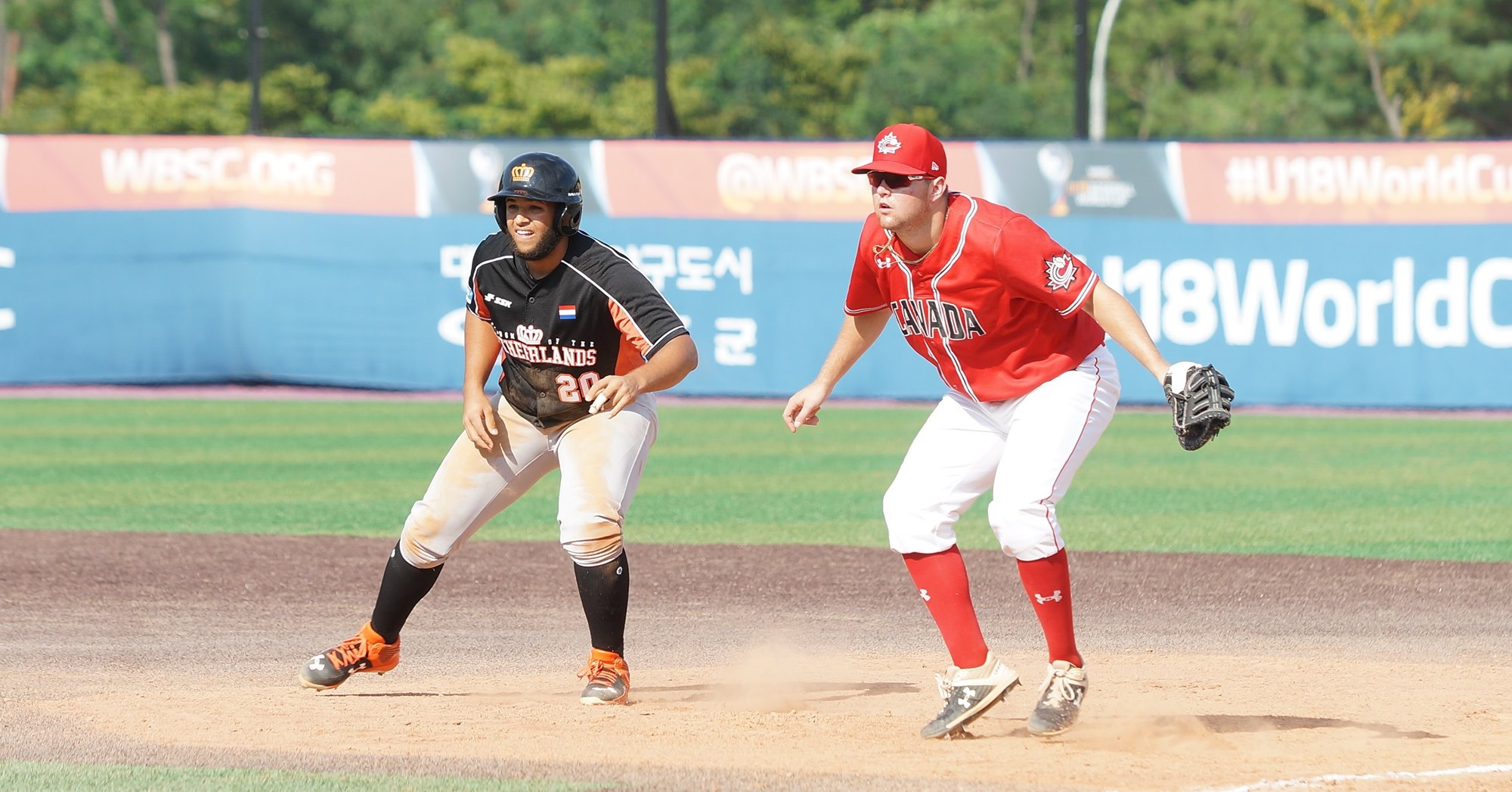 Canada's Noah Hull defends first base against Shane Quant of The Netherlands