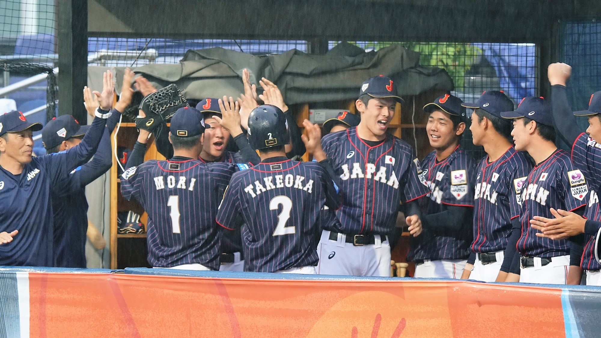Japan celebrates the first run of the game