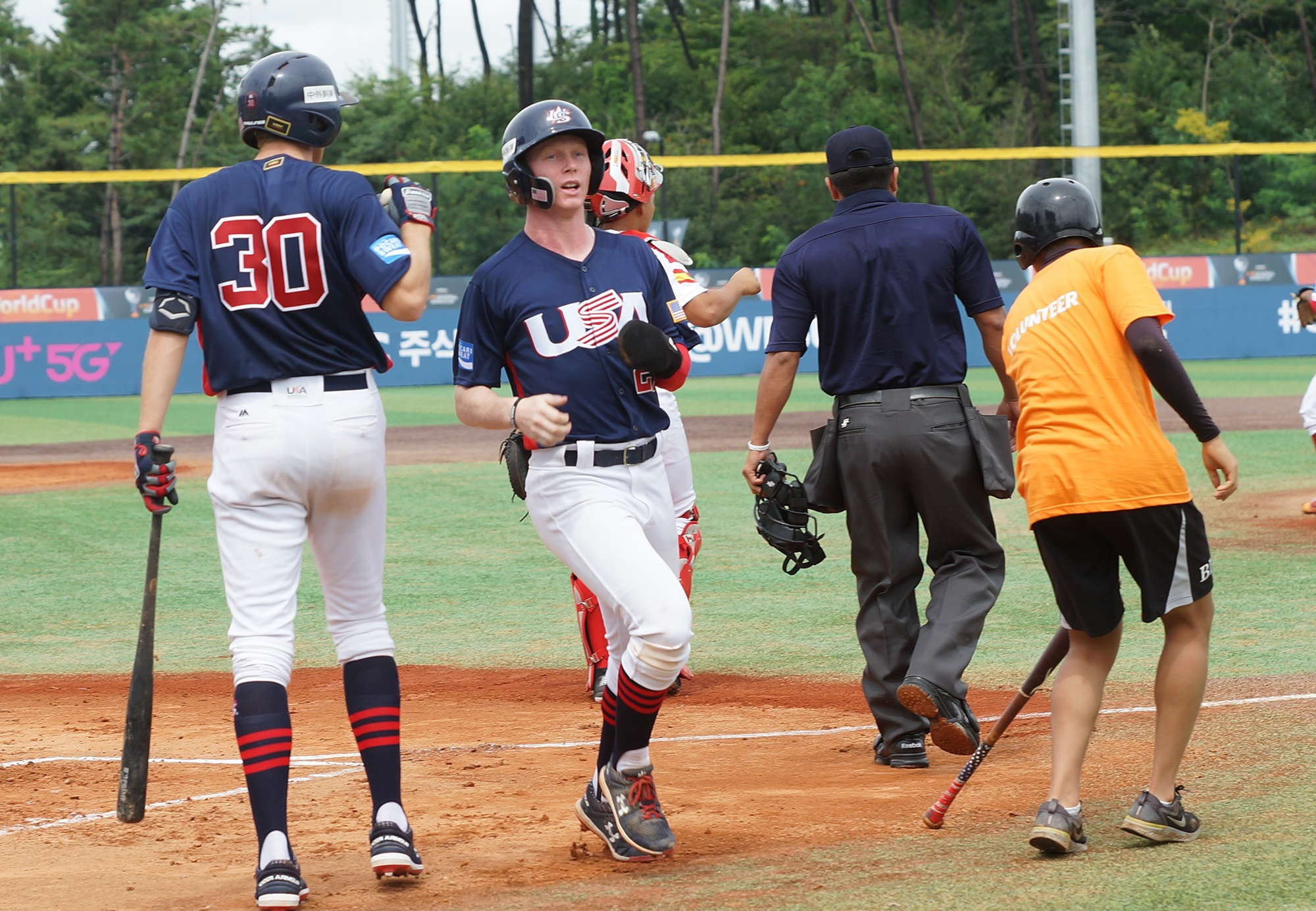 The USA scores in the first inning