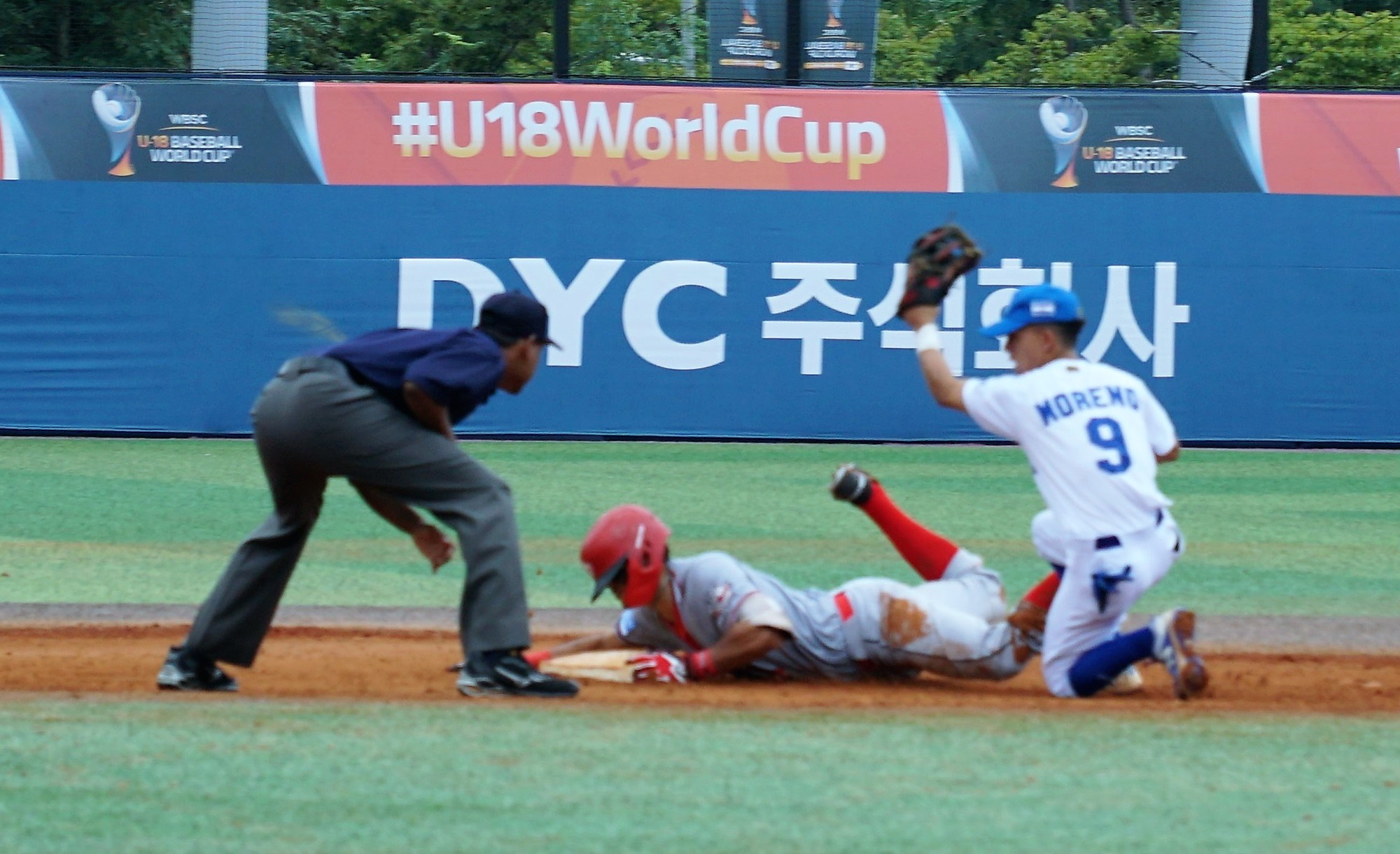 Nicaragua shortstop Christian Moreno tries to get a tag out at second
