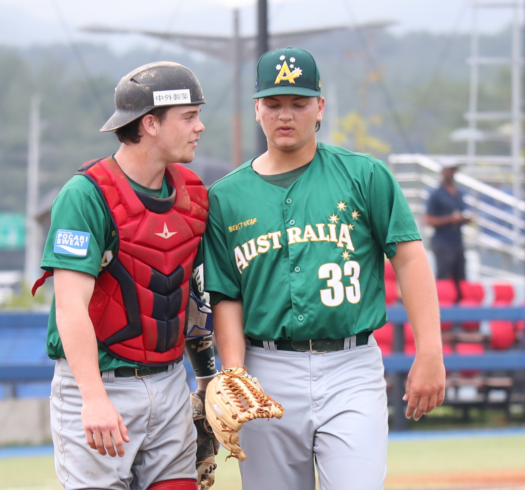 Catcher Christopher Burke talks to starting pitcher Sherriff