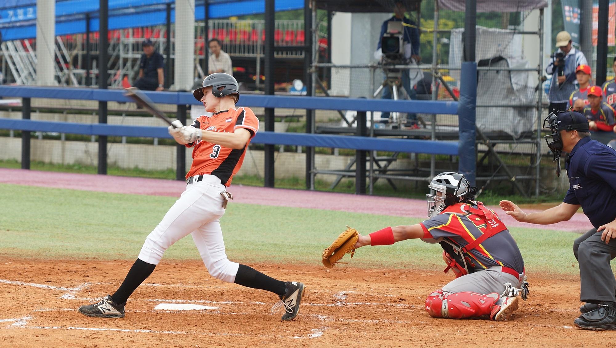 Nick Hofer swings the bat